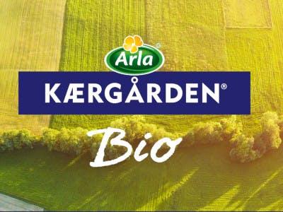 Feld und Wiese - grün-gelb gehalten - mittig das Arla Logo