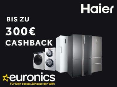 """Küchen-Großgeräte auf Schwarzem Hintergrund, oben rechts Haier-Logo, unten links Euronics-Logo, links im Bild """"bis zu 300€ Cashback"""""""