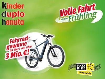 Grüner Bildhintergrund, Kinder Duplo und Hanute Logos oben links im Bild, darunter ein E-Bike mit der Gewinnbeschreibung, unten rechts das Lucky Bike Logo und oben der Aktionsslogan