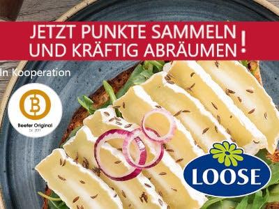 Käsescheiben im Hintergrund, oben im Bild ein roter Streifen mit roter Schrift, Aktionsbeschreibung, unten rechts das Loose-Logo