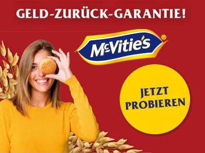 Roter Bildhintergrund, links im Bild Frau mit Keks vor dem linken Auge, rechts ein gelber Jetzt Probieren Button, darüber das McVities Logo, ganz oben der Aktionsslogan
