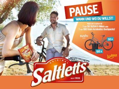 Frau und Mann mit Fahrrädern im Bild, sie hat eine Saltletts Packung in der Hand, rechts die Aktionsbeschreibung, unten das Saltletts Logo