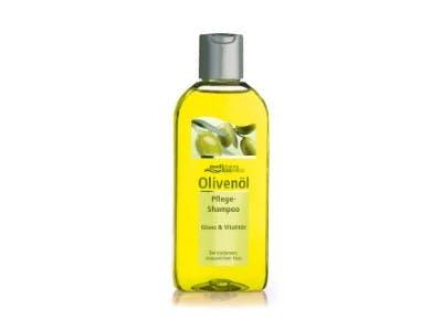 Flasche mit gelbem Olivenöl-Shampoo auf einem weißen Hintergrund