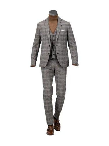 Schaufensterpuppe, die einen karierten Anzug trägt